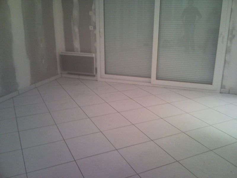 Joint carrelage salon notre construction for Joint pour carrelage blanc